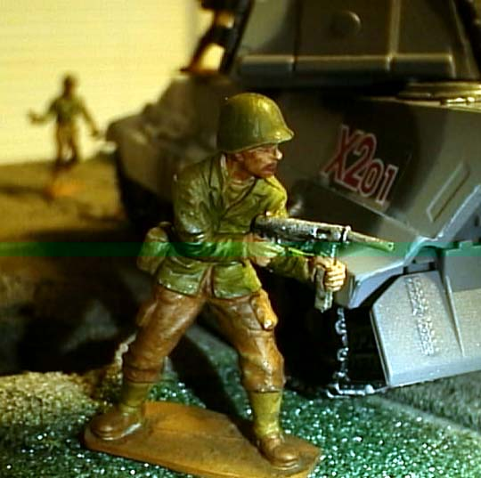 Sarge gives cover fire with his greasegun...